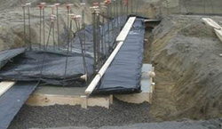 concrete blankets used during pouring of foundation footing in winter